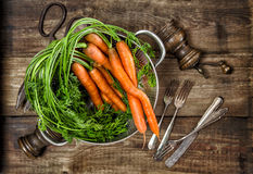 Fresh carrots on wooden background. Vegetable. Vintage style foo Stock Images