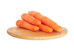 Fresh carrots on wooden board Stock Photo