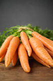 Fresh carrots on wooden table Royalty Free Stock Image