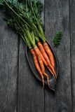 Fresh carrots on wooden table Royalty Free Stock Images