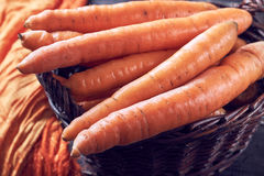 Fresh carrots in woven basket Stock Photo