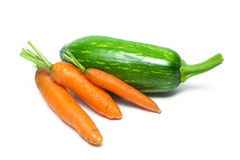 Fresh carrots and zucchini isolated on a white background Stock Images