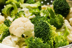 Fresh cauliflower and broccoli. Close-up Royalty Free Stock Images
