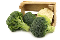 Fresh cauliflower and broccoli in a wooden crate Stock Photos