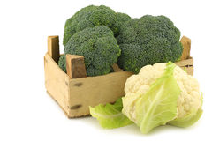 Fresh cauliflower and broccoli in a wooden crate Stock Photo