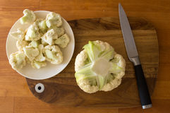 Fresh cauliflower and knife on cutting board and cauliflower pie Royalty Free Stock Photography