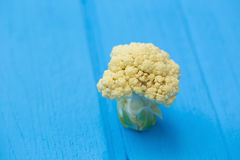 Fresh cauliflower with vegetables on a wooden table. Fresh cauliflower with vegetables on a wooden table Stock Images