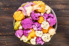 Fresh cauliflowers top view. Fresh cauliflowers top view in bowl on rustic dark wood  background Royalty Free Stock Image