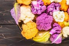Fresh cauliflowers top view. Fresh cauliflowers top view in bowl on rustic dark wood  background Royalty Free Stock Photos