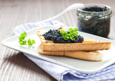 Fresh caviar on toast Stock Photo