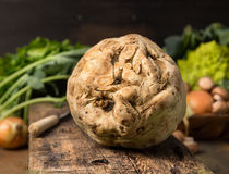 Fresh celeriac on rustic wooden background Stock Photography