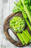 Fresh celery on a cutting Board. On wooden background royalty free stock image