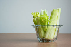 Fresh celery in glass bowl. Royalty Free Stock Photography
