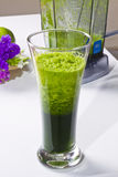 Fresh Celery Juice. In glass. Electric juicer in background Stock Photo