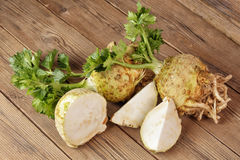 Fresh celery root. On a wooden board, one cut Stock Images