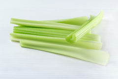 Fresh celery stems on the white table Royalty Free Stock Image