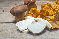 Fresh Chanterelle and Boletus Edilus mushrooms on a wooden table Stock Photo