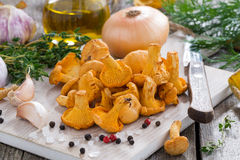 Fresh Chanterelles And Ingredients For Cooking On Wooden Board Stock Photos