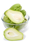Fresh Chayote. Whole and sliced fresh Chayote vegetables in a glass bowl, isolated on white studio background Royalty Free Stock Image