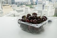 Fresh cheery in a plastic bowl for health. Y diet Stock Image