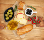 Fresh cheese, bread olives and tomatoes Stock Photography