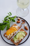 Fresh cheese canape with sliced nectarine and cucumber Royalty Free Stock Photo