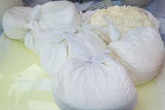 Fresh cheese in cheesecloth. Traditional cheese making with cheescloth Royalty Free Stock Photos