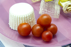Fresh cheese with cherry tomatoes Royalty Free Stock Image
