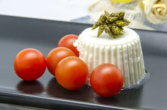 Fresh cheese with cherry tomatoes Stock Photography