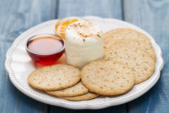 Fresh cheese with cookies and jam on white dish Stock Photos