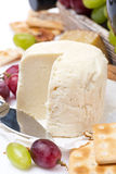 Fresh cheese, crackers and fruit, close-up Stock Photo