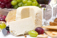 Fresh cheese, crackers and grapes, close-up Royalty Free Stock Photo
