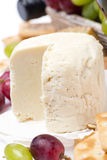 Fresh cheese and fruit, close-up Royalty Free Stock Photo
