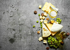 Fresh cheese with grapes and white wine. Royalty Free Stock Photography