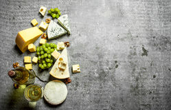 Fresh cheese with grapes and white wine. Royalty Free Stock Images