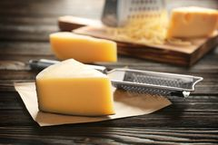 Fresh cheese and grater. On wooden table royalty free stock photography