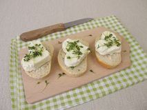 Fresh cheese hearts with cress sprouts on baguette. Homemade fresh cheese hearts with cress sprouts on baguette Stock Photography