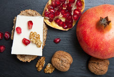 Fresh cheese with pomegranate and nuts Stock Images