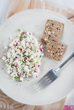 Fresh cheese salad with radish and herbs on plate Stock Photography