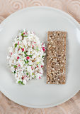 Fresh cheese salad with radish and herbs on plate Stock Photo