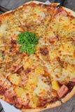 Fresh cheese supreme and hawaiian pizza Royalty Free Stock Image