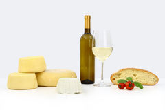 Fresh cheese and wine and bread Stock Images