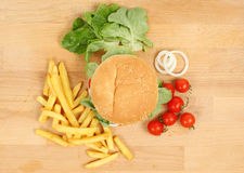 Fresh cheeseburger with fries Royalty Free Stock Images