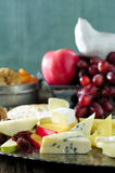 Fresh cheeses and fruits Royalty Free Stock Photo