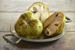 Fresh cherimoya fruits Annona cherimola on an old tray royalty free stock photo