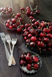 Fresh cherries in aluminum plates Royalty Free Stock Photography