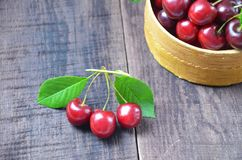 Fresh cherries in bowl on table Royalty Free Stock Photo