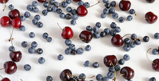 Fresh cherries and blueberryon a cloth from flax,. Top view. Berry mix Stock Images