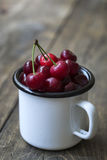 Fresh cherries in bowl on table Stock Images
