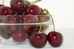 Fresh cherries in a bowl on the table. Delicious and fresh, juicy and sweet summer fruit. Red cherries in a glass bowl Royalty Free Stock Images